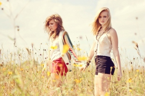 Girls Holding Hands in a Field