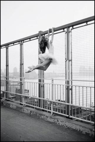 Ballerina Hanging on a Fence